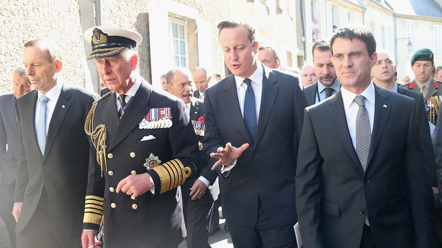 Prime ministers of Australia, Britain and France attended a service in Bayeux