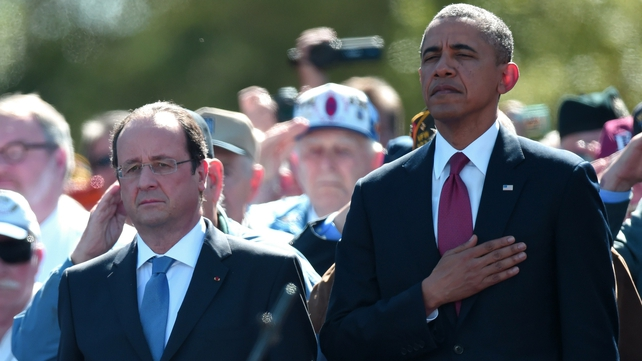 Barack Obama and Francois Hollande attended a ceremony at the US war cemetery at Omaha Beach