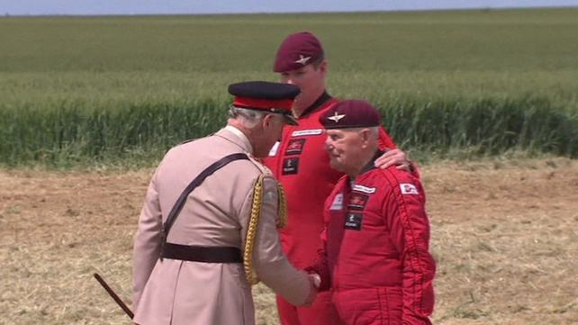 An 89-year-old war veteran meets Britain's Prince Charles after parachuting into the French village of Ranville ahead of D-Day anniversary events