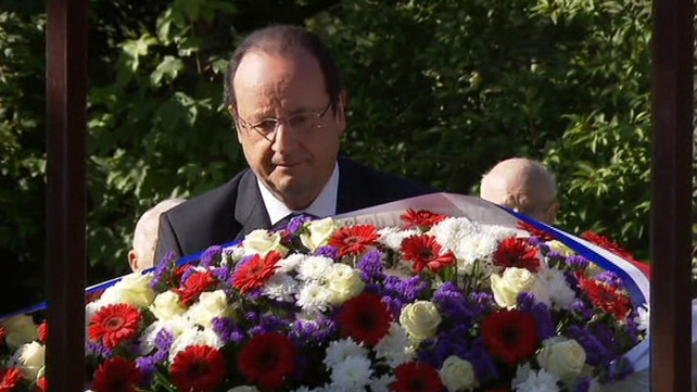 French President Francois Hollande lays a wreath to civillian victims of World War II in Caen, Normandy