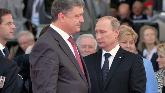 Vladimir Putin and Petro Poroshenko during the D-Day commemorations in France