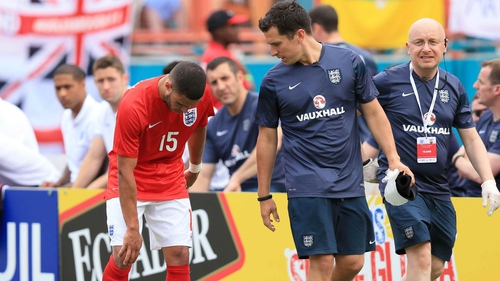 Alex Oxlade-Chamberlain walks off the pitch with a knee injury during Wednesday's friendly