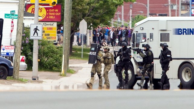 Armed emergency response police officers were involved in the hunt for the gunman in Moncton