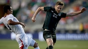 Ireland's Kevin Doyle with Michael Umana of Costa Rica during the game