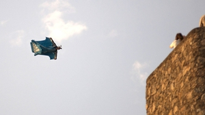 A Spanish man in midflight at a base jumping exhibition event in Andalusia, southern Spain