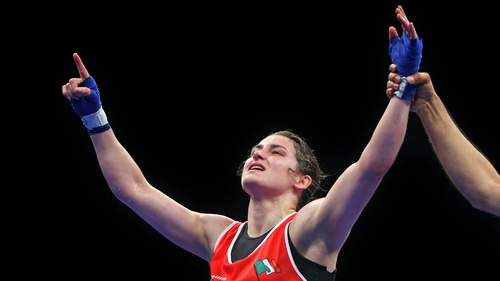 Katie Taylor celebrates on hearing she has won the title