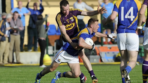 Longford's Shane Doyle is fouled by Paddy Byrne of Wexford
