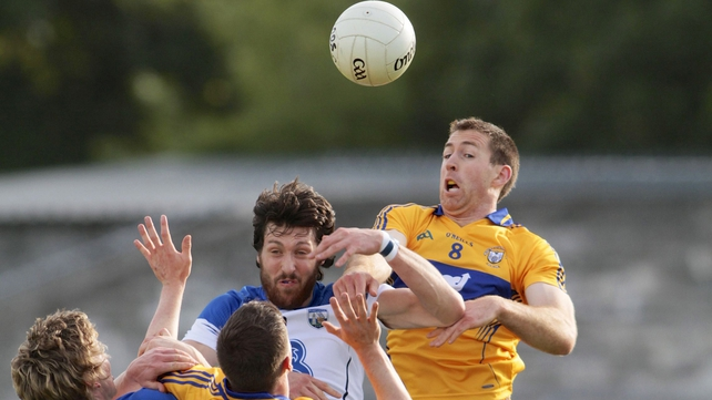 Tommy Prendergast of Waterford with Gary Brennan of Clare (R)