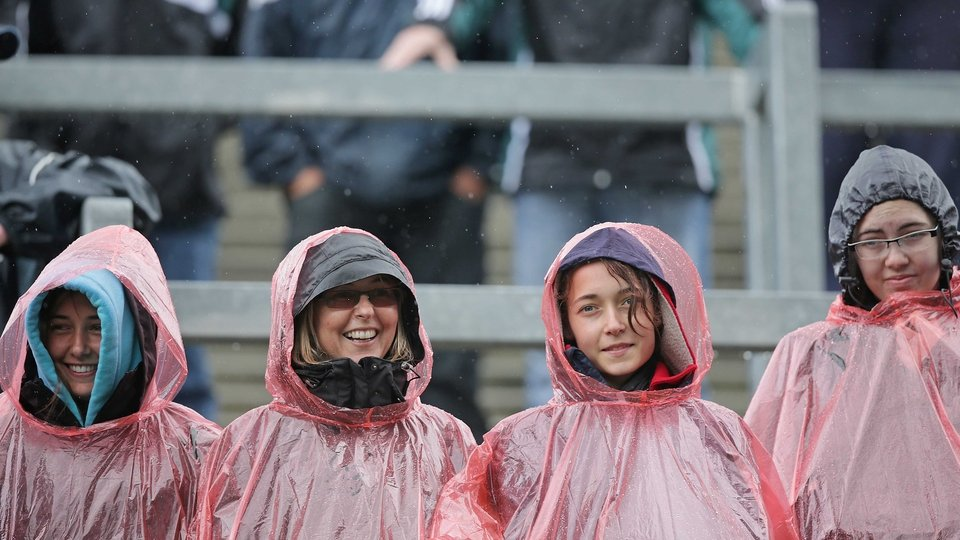 Fans shelter from a rain shower on the Hill at Croke Park on Sunday