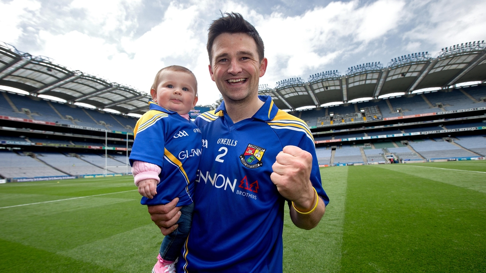 Longford's Conor Egan celebrates with his daughter Elayna after the Lory Meagher final