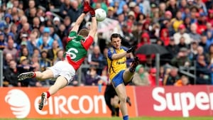 Mayo's Colm Boyle takes to the skies to try and stop Diarmuid Murtagh of Roscommon