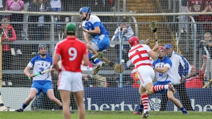 Waterford's Stephen O'Keeffe rushes out to block a penalty from his Cork counterpart Anthony Nash
