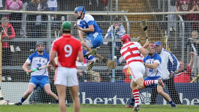 Stephen O'Keefe saves Anthony Nash's penalty by rushing off his line before the sliotar is struck