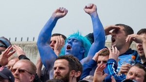 A Dublin fan shows his true colours on Hill 16 on Sunday