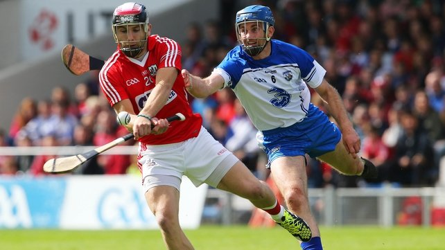 Paudie O'Sullivan in action evading the hook of Waterford's Michael Walsh
