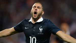 Karim Benzema celebrates after scoring for France