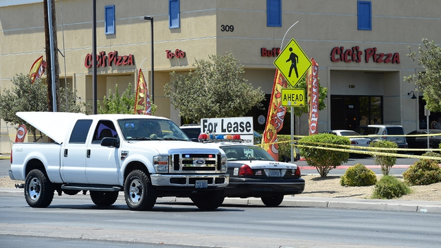 A Las Vegas police officer died at the scene, while the second subsequently died in surgery