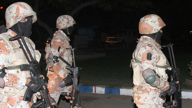 Pakistani Rangers secure the Jinnah International Airport after suspected militants attacked the airport in Karachi