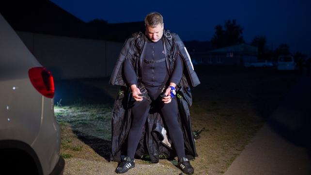 Remo Lang prepares for his jump in his wingsuit