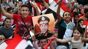 Egyptians celebrate the swearing-in of President-elect Abdel Fattah el-Sissi in Cairo, Egypt