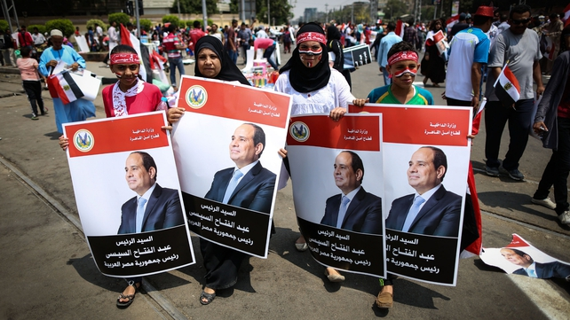 Egyptians celebrating the inauguration of Abdel Fattah al-Sisi yesterday