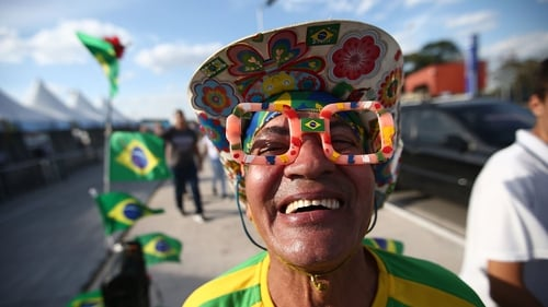 A Brazil fans poses outside of FIFA World Cup opening ceremony rehearsals around Itaquerao stadium, Sao Paulo, Brazil