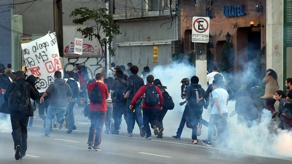 Police use tear gas to disperse the protesters