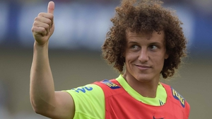 Brazil's David 'Krusty the Clown' Luiz gestures a sign of approval to the crowd