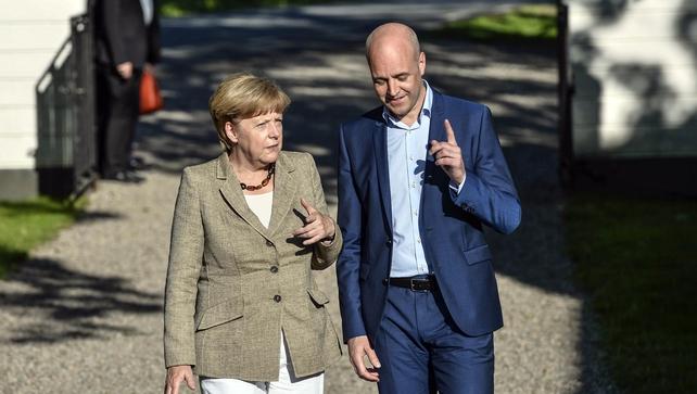 Fredrik Reinfeld and Angela Merkel  in the garden of Mr Reinfeldt's summer residence in Harpsund, Sweden