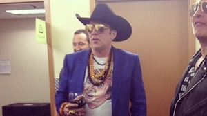 Nicolas Cage wearing a Nicolas Cage t-shirt backstage at a show