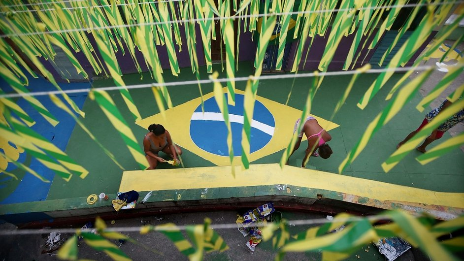 Brazilians paint a section of Rio de Janeiro's Santa Marta shantytown, or 'favela', in their country's colours ahead of the 2014 World Cup