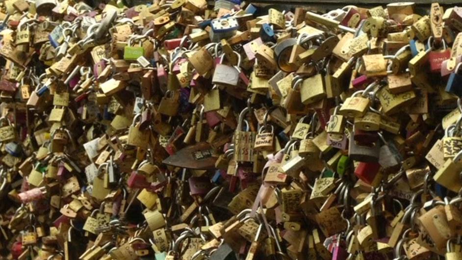 Part of Paris' Pont des Arts footbridge collapses under the weight of symbolic 'love locks'