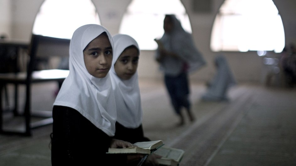 Palestinian girls study Islam's holy book the Koran during a summer camp in Gaza City