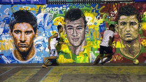 A mural featuring some of the likely stars of World Cup 2014