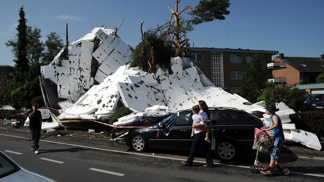 The remains of a roof damaged in the storms are dispersed in Neuss, Germany