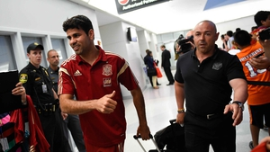 Diego Costa arrived back home in Brazil in high spirits