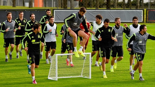 Spain's squad trained at the   players warm up during a Spain training session at the Centro de Entrenamiento do Caju in Curitiba on Monday