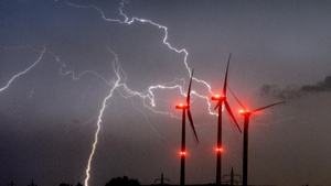 Lightning flashes in the sky over wind turbines in the district of Hildesheim, Lower Saxony, Germany