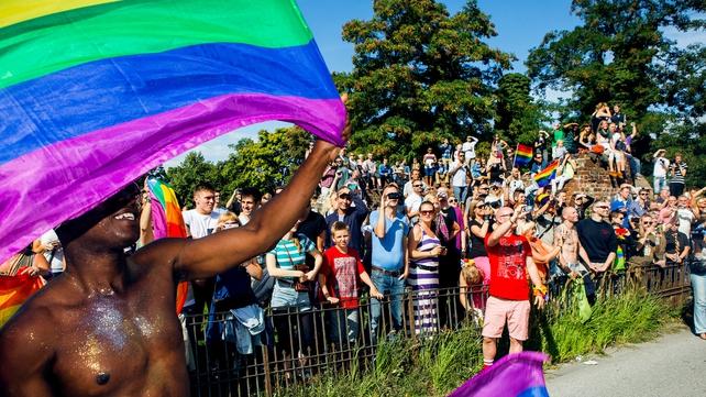 Participants of the Copenhagen Pride Parade walk through a street in Copenhagen, Denmark last August