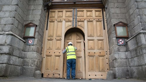 A worker puts the finishing touches to the door (Pic: Paul Sharp, sharppix.ie)