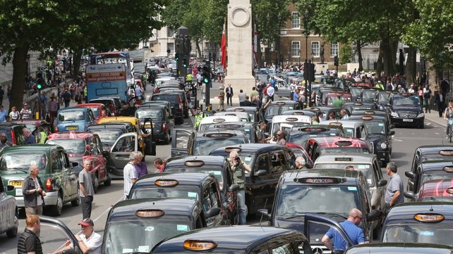 Taxis blockade Whitehall in London in opposition to the new smartphone app