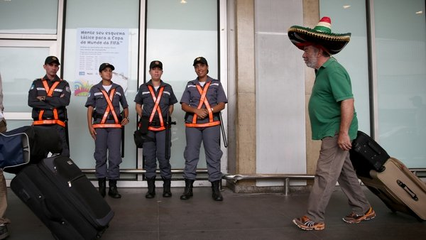 A Mexican soccer fan arrives at the Rio de Janeiro Galeao International Airport