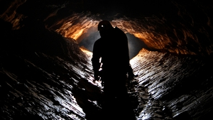 Over 100 emergency workers have struggled to rescue the trapped cave explorer