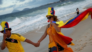 Colombian soccer team fans enjoy Copacabana Beach in Rio as they await the start of the tournament