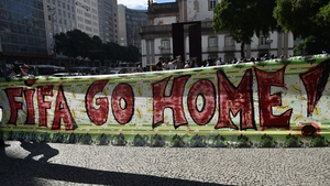 A huge banner against FIFA is carried during an anti-World Cup protest in Rio de Janeiro