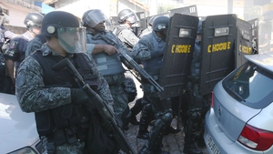 Brazilian police react to a protest ahead of the World Cup