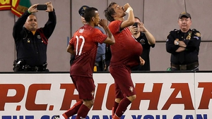 Portugal's Fabio Coentrao celebrates scoring against Ireland with Nani