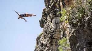 Cesilie Carlton dives from the 20m platform at Hells Gate during a training session of the second stop of the Cliff Diving World Series