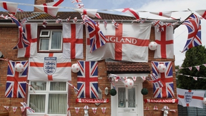 England flags adorn a house on a street in the Knowle West area of Bristol on Wednesday