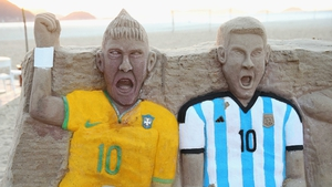 A sandcastle of Neymar of Brazil and Lionel Messi of Argentina on Copacabana beach on Monday